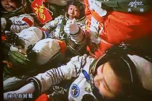 Chinese astronauts Liu Wang, Jing Haipeng and Liu Yang sat inside the Shenzhou 9 capsule as it docked with the orbiting module Tiangong 1 on Monday.