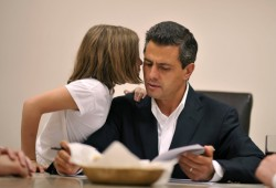 Presidential candidate Enrique Pena Nieto of the Institutional Revolutionary Party (PRI) talks with his daughter Regina as he awaits the election results on July 2, 2012 in Mexico City, Mexico. Results of an official preliminary count later indicated that Mexico's presidential election front-runner Enrique Pena Nieto holds a substantial lead over Andres Manuel Lopez Obrador.