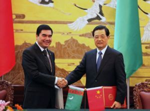 President Hu Jintao shakes hands with Turkmenistan's President Gurbanguly Berdymukhamedov during their meeting on Wednesday in Beijing. Turkmenistan has agreed to substantially increase natural gas supplies to China. Xu Jingxing / China Daily