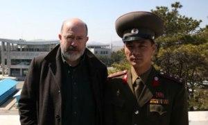 John Sweeney with North Korean soldier