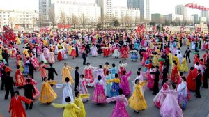 North Koreans dance on a street in Pyongyang
